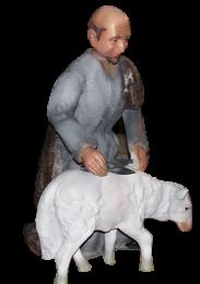 Figura de belén de esquilador con oveja